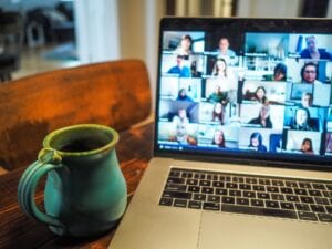 Zoom meeting and a mug next to laptop
